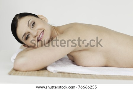 Beautiful dark-haired woman relaxing in a spa centre