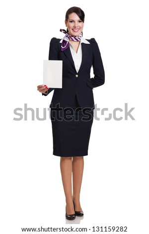 Beautiful dark haired young business woman dressed in a navy suit with a purple scarf standing and holding a blank sheet of cardboard in her right hand, isolated on white background - stock photo