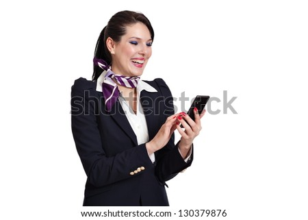Beautiful dark haired young business woman dressed in a navy suit with white shirt and a purple scarf standing laughing checking her mobile phone, isolated on white background - stock photo