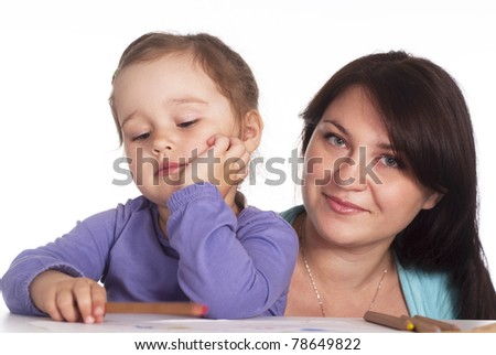 beautiful daughter draws with her mother