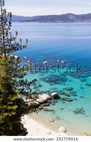 beautiful day at Lake Tahoe, clear blue water reflecting the blue sky - stock photo