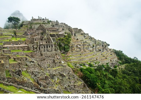 Beautiful day at the ancient ruins of Machu Picchu, Peru - stock photo