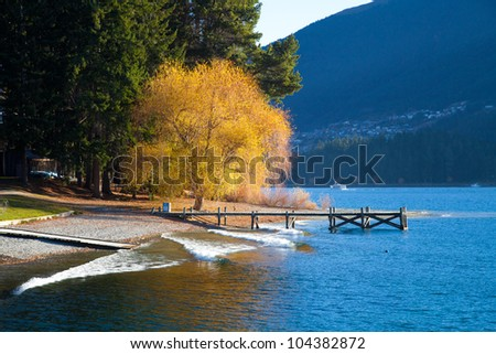 Beautiful day at the Wakatipu lakein early autumn Queenstown Southern island New Zealand - stock photo