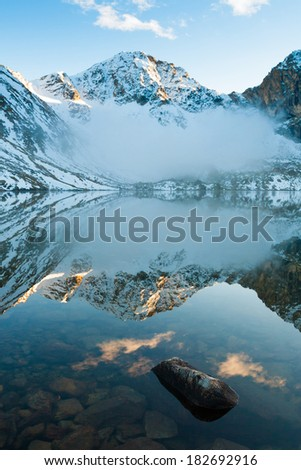 beautiful day in the autumn lake of the mountain - stock photo