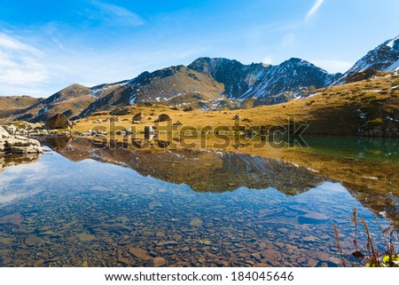 beautiful day in the autumn lake of the mountain