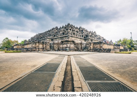 Beautiful day with dramatic clouds at the Borobudur Temple of Java Island - stock photo