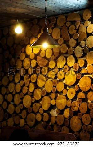beautiful decor wall of wooden logs. - stock photo