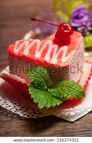 Beautiful decorated cake, heart shape - stock photo