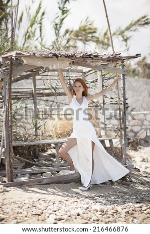 Beautiful Decorated Romantic house with woman in white wedding dress nature - stock photo