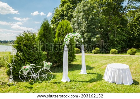 Beautiful Decorated Romantic place during outdoor wedding ceremony - stock photo