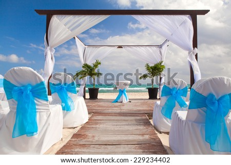 Beautiful Decorated Romantic Wedding  on Sandy Tropical Caribbean Beach. - stock photo