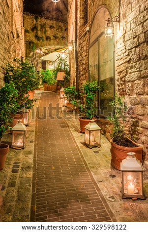 Beautiful decorated street in small town in Italy, Umbria - stock photo