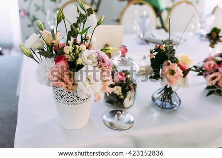 Beautiful decoration with flowers on the table - stock photo
