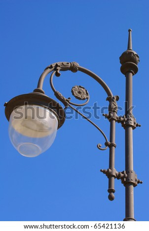 Beautiful decorative lantern, against the blue sky