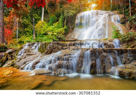 Beautiful Deep Forest Mae Kae Waterfall in the forest unseen Ngao district, Lampang, Thailand. - stock photo