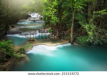 Beautiful deep forest waterfall - stock photo