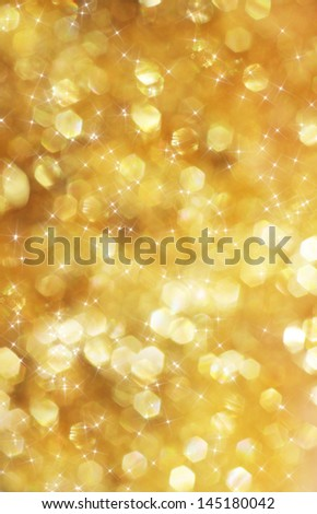 Beautiful defocused golden background with white stars - stock photo
