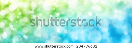 Beautiful defocused highlights in nature create a panorama bokeh composition in green and blue, ideal as a wide format background or banner - stock photo