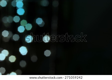 Beautiful defocused LED lights filtered bokeh abstract with green-black tone background for text input. - stock photo