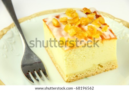 Beautiful delicious cheesecake on red background - stock photo