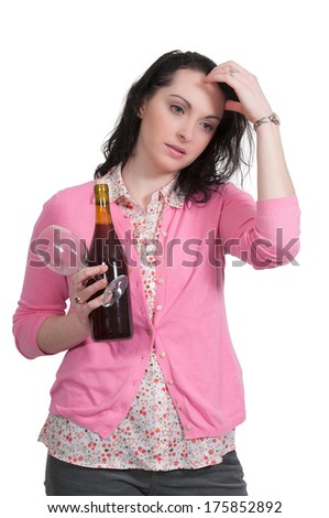 Beautiful depressed woman holding a bottle of wine
