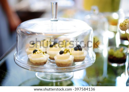 Beautiful desserts, sweets and candy table at wedding reception or other event - stock photo