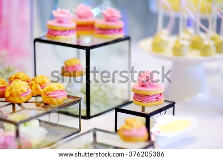 Beautiful desserts, sweets and candy table at wedding reception ot other event - stock photo