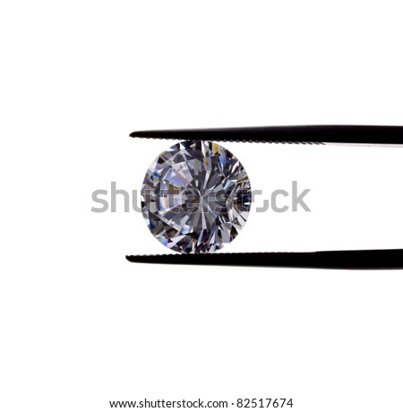 beautiful diamond being held by tweezers. - stock photo