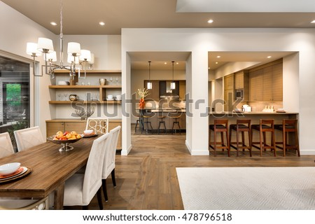 Beautiful Dining Room And Kitchen Interior In New Luxury Home Features Hardwood Flooring Exquisite