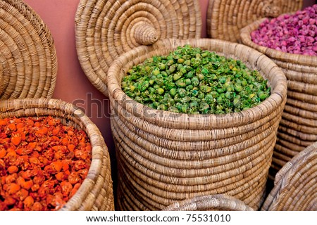 Beautiful display of dried flowers at a small Moroccan spice store. - stock photo
