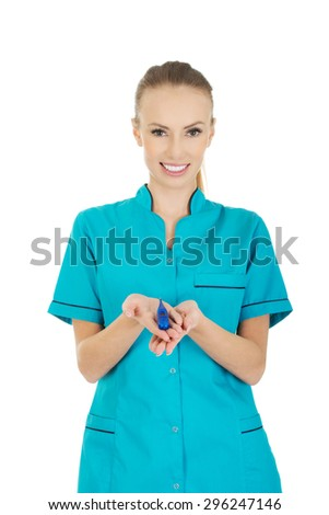 Beautiful doctor woman with a thermometer.