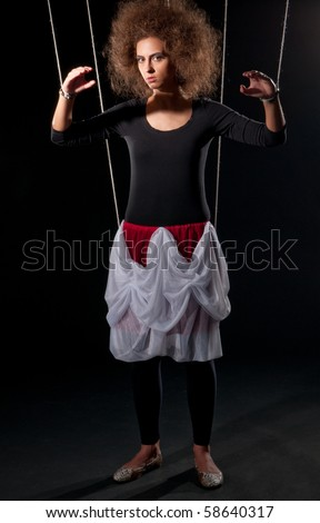 Beautiful doll women with control line standing on black