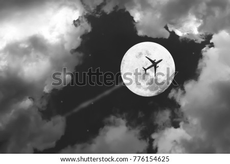 Beautiful Dramatic Atmosphere Of Airplane In Black And White Night Sky With Jet Full Moon