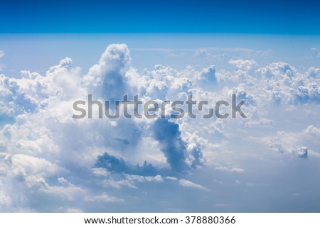 Beautiful, dramatic clouds and sky viewed from the plane. High resolution and quality - stock photo