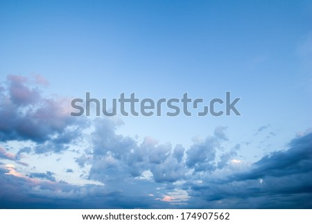 Beautiful, dramatic, colorful clouds and sky. Image has grain texture seen at 100 percent of its size. - stock photo