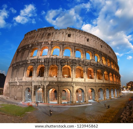 Beautiful dramatic sky over Colosseum in Rome. - stock photo