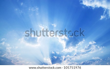 Beautiful dramatic sky with sun rays. - stock photo