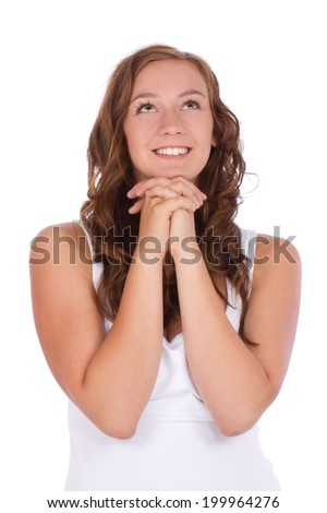 Beautiful dreaming teenage young woman looking up - stock photo