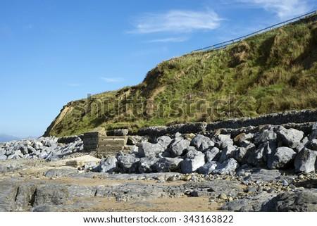 beautiful dunes and wave breakers at ballybunion beach in ireland - stock photo