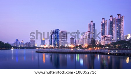 beautiful dusky sky of modern building and city life landmark in heart of bangkok capital of thailand office building and reflection on water pool against twilight sky - stock photo
