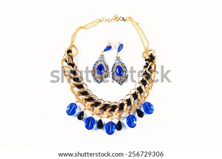 Beautiful earrings with necklace isolated on white - stock photo