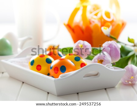 Beautiful Easter decor with fresh tulips  - stock photo