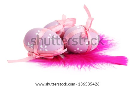 Beautiful easter eggs and decorative feathers, isolated on white