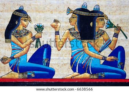 beautiful egiptian papyrus - three girls holding a lotus flower - beauty concept - stock photo