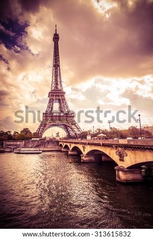 Beautiful Eiffel Tower in Paris France under golden light - stock photo