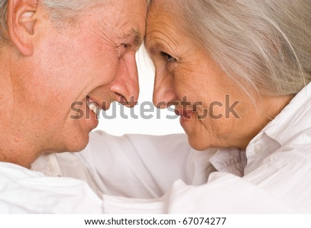 beautiful elderly couple together on a white - stock photo