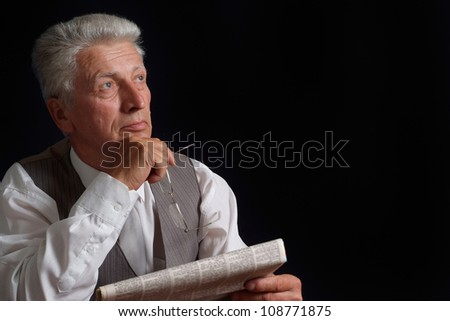 Beautiful elderly man in suit on black background