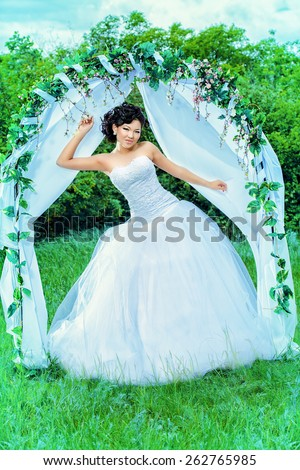Beautiful Elegant Asian Bride Stands Under Stock Photo & Image ...