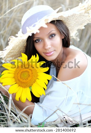 beautiful elegant brunette girl in a field - stock photo