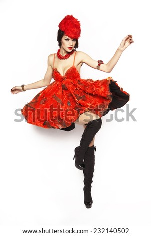 Beautiful elegant brunette woman in red dress isolated on white background - stock photo